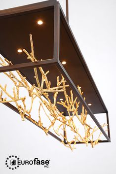 The Aerie chandelier features delicate gilded branches floating elegantly within an open linear frame. #interiordesign #lighting #decor #chandelier #gilded #gold #branches #coral #twigs #nature #glam #coastal #restaurant #kitchen