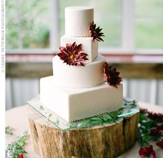 *Alternating Round & Square Tiers...The Cake: The sleek four-tiered wedding cake was coconut with raspberry and chocolate ganache.