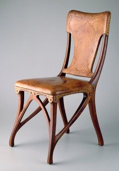 Eugéne Gaillard (1862-1933) - Side Chair. Carved Wood with Embossed Leather Seat & Back. Circa 1900.