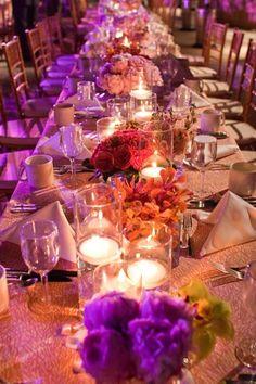 Long tables, fuschia peonies, votives.