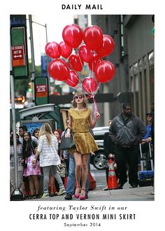 The ever adorable Taylor Swift was spotted sporting our perfectly fall gold matching set and a dozen red balloons in NYC recently - quite the photo op! #aliceandolivia #taylorswift