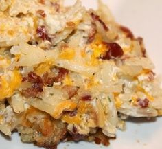 Loaded Baked Potato Casserole Recipe: frozed shred potato, 16oz sour cream, 3oz pkt of real bacon pieces, 2c. Shredded cheddar. Mix, place in greased 9*13 pan. 400° for 50-60mins. Till browned