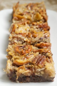German Chocolate Pecan Pie Bars | Bake or Break.  3 cups pecan halves  1 & 3/4 cups all-purpose flour  3/4 cup confectioners' sugar  3/4 cup cold butter, cubed  1/4 cup unsweetened cocoa  1 & 1/2 cups semisweet chocolate chips  3 large eggs  3/4 cup firmly packed light brown sugar  3/4 cup light corn syrup  1/4 cup unsalted butter, melted  1 cup sweetened flaked coconut
