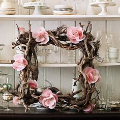 This beachy wreath uses flowers, shells, and rocks.