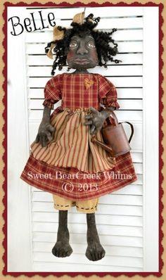 Belle a primitive black doll $8.00
