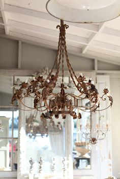 would love this chandelier hanging on back porch...heck bedroom would be pretty too.
