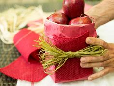 7.How to Create a Farmers Market Style Centerpiece: Secure the burlap ribbon in place along the front of the bag with twine or strands of hay. From DIYnetwork.com