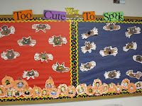 Too Cute Too Spook Bulletin Board with bats made from hand prints.