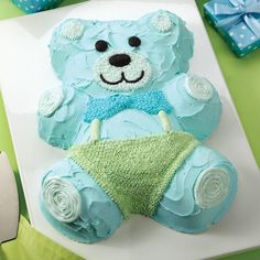 Wilton shaped pans are ideal for birthday parties or any celebration. This easy, fun teddy bear is the perfect example! He's iced all over, then dressed up with star fill-in clothes and swirl, dot and outline features.