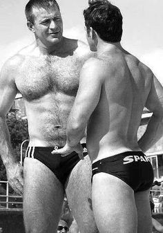 An Adidas daddy and a Spanks swimwear boy getting into a verbal altercation over who saw that hot, hairy Speedo Bear first! (Who's not shown in this picture)