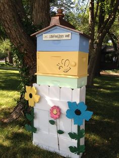 "Ann Meats. Pittsburg, KS. As beekeepers, we wanted to create a theme for our Library of bees and beekeeping. The inside of the library has a honeycomb stencil, the Library is made from real bee hive boxes, and the""roof"" is a modified garden hive style."