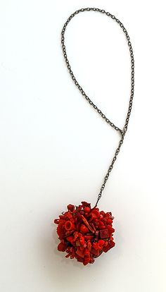 Robin Ayres – A ball of red – vintage glass and plastic beads, Cracker Jack pieces, game pieces, fuses, gaskets, and much, much more