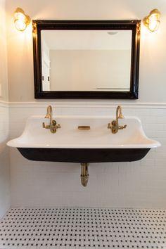 black sink + brass hardware + floor tile