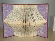 Repeating Single Point Folded Book Art (  Book Origami). $24.95, via Etsy. - plus he offers an ebook on how to do it