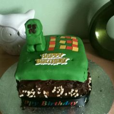 My sons 13th birthday cake I made him. Minecraft block