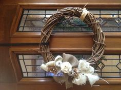 Grapevine wreaths made with burlap, recycled fabric into flowers & beads.