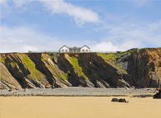 NORTHCOTT BEACH HOUSE Nr Bude, Cornwall, United Kingdom  A breathtaking cliff-top large holiday home in north Cornwall offering beach side comfort for up to 17 guests