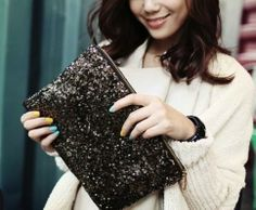 Give your bag collection some shimmer with this sequin clutch. $24 www.mooreaseal.com
