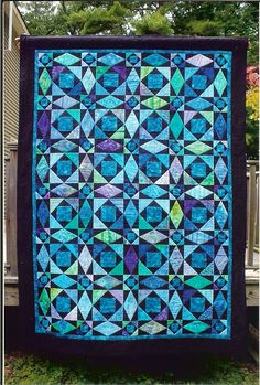 Another gorgeous Storm at Sea quilt by Quilted with TLC. In Batiks.