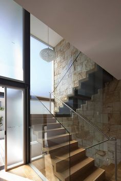 Vaucluse House/MPR Design Group  Fancy chandelier in my stairwell, that has a glass wall? Yes, please!