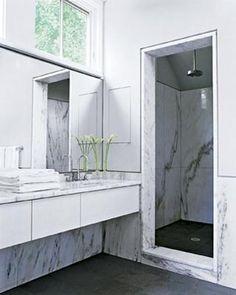 Floating vanity marble walls and doorless shower enclosure. http://marblebathdeborahberke.jpg