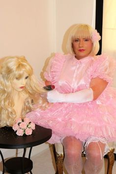 Sissy Maid Isla is under sissy hypnosis brushing out wigs.