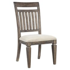 Bring timeless style to your dining room or den with this charming upholstered side chair, showcasing a slatted back and an aged patina finish. ...