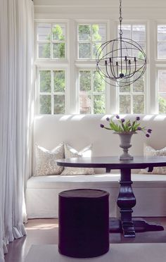 simple mix of rustic orb and table with white banquette - we sell a very similar chandelier in our online store!
