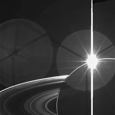"This photo was taken just after the famous ""In Saturn's Shadow"" portrait of Saturn eclipsing the Sun, when the Sun had emerged from behind Saturn, on September 15, 2006. The image has not been processed except for calibration."