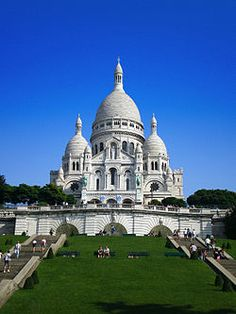 The Basilica of the Sacred Heart of Paris | commonly known as Sacré-Cœur | Basilica (French: Basilique du Sacré-Cœur | pronounced [sakʁe kœʁ]) | is a Roman Catholic church and minor basilica | dedicated to the Sacred Heart of Jesus | in Paris | France | A popular landmark, the basilica is located at the summit of the butte Montmartre | the highest point in the city |