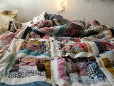 Beautiful scrappy hand tied log cabin quilt