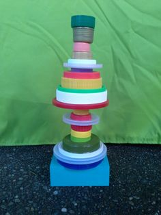 Lids have been transformed into a colorful Dr. Seuss-like tower.
