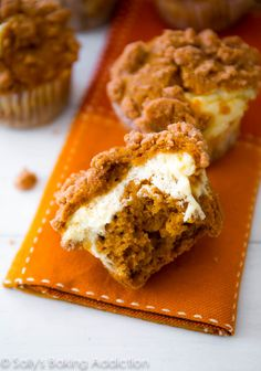Super-moist Pumpkin Spice Muffins filled with cheesecake and topped with brown sugar streusel. So good!