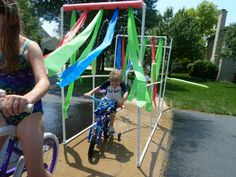 Great idea for kids birthday party (or just plain ol' summer time fun)...diy Kiddie Car Wash, from pvc pipe, strips cut from plastic table cloths, add a couple dollar store pool noodles...and a hose! let the kids ride their bikes thru...or just take a stroll thru. easy to disassemble to store