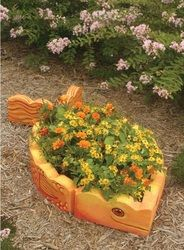 Paint a fish out of concrete landscaping edging! Summer craft for kids :)
