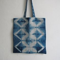 Lines and squares in indigo blue. Tote in 100 % linen - in itajime shibori.