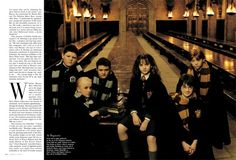 At Hogwarts, From left to right: gathered on the set of the Hogwarts School's Great Hall are Jamie Waylett as Crabbe, Tom Felton as Draco, Harry's nemesis, and Joshua Herdman as Goyle, all of Slytherin House, and Emma Watson as Hermione, Daniel Radcliffe as Harry Potter, and Rupert Grint as Ron, all of Gryffindor House.  Photographed by Annie Leibovitz for Vanity Fair October 2001