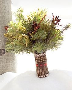 Bridesmaids' nosegays of fir, wild pine, cedar, aspen twigs, and berries swathed in houndstooth wool
