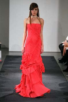 Look 12 | Coral strapless chiffon mermaid gown with alternating pleat bodice, organic flower detail and pleated tier skirt.