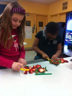 Cutting juicy strawberries for a sweet and healthy berries and yogurt snack.