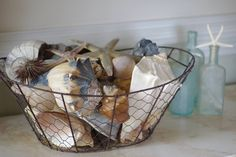 Wire basket with hand collected shells from By the Seashore Decor: https://www.facebook.com/ByTheSeashoreDecor/photos/a.172252022848080.44656.154228591317090/737038569702753/?type=1&theater