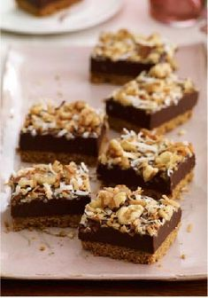 Coconut Fudge Bars — Rich, chocolaty dessert bars topped with sweet coconut and walnuts? Count us in. Serve these decadent treats to your crowd, and accept the compliments as they come in.