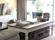 i like the antique trunk under the coffee table, it's pretty and functional storage