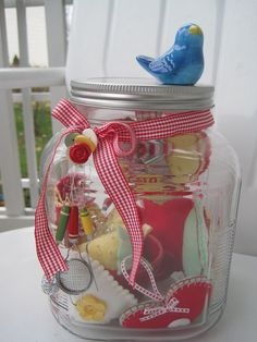 Old coffee and candy jars for buttons, ribbons, empty thread spools, and much more
