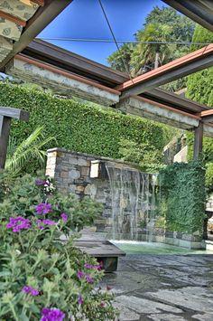 Einmalige Gartenanlage mit schönem Wasserfall, Orselina