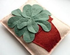 Applique Succulent Sachet tutorial by Laura Howard from Bugs and Fishes. Get your creative side going by making a felt applique succulent for your next sachet.
