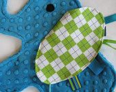 "cute different idea for a baby ""taggy"" blanket. rather than just square an animal shape."