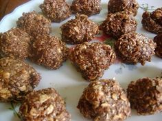 Mudballs  1/4 cup peanut butter  1/4 cup honey  1/4 cup wheat germ  1/2 cup oatmeal  1/4 cup chocolate chips   1/4 cup sesame seeds  Cook the peanut butter and honey over low heat until melted. Add remaining ingredients. When cool enough to handle roll into oohey gooey mud balls.