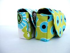 A cute little loyalty card holder, but it could really hold almost anything. Nice pattern! Magnetic snap.