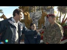 """Watch this video! A heart warming moment during the 2013 Rose Parade® with a personal look of the soldier being reunited with his family. A very emotional moment when Sergeant First Class Eric Pazz jumps off the Natural Balance® """"Canines With Courage"""" float to surprise his wife and son during the parade and on national television. With exclusive interviews, perso..."""